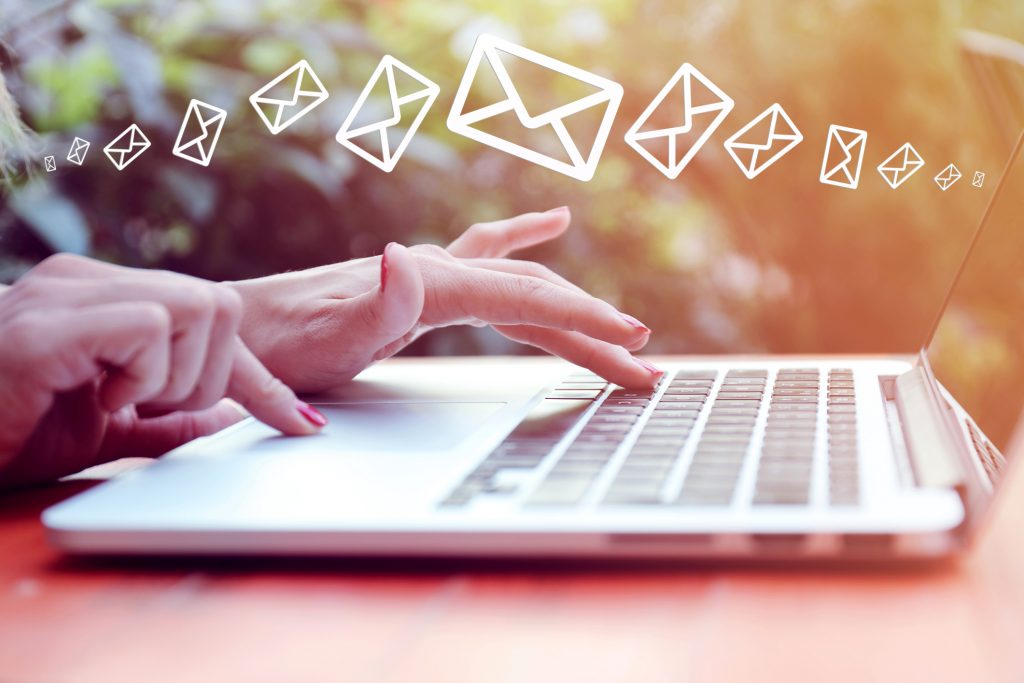 a graphic representing the different between direct mail and email marketing